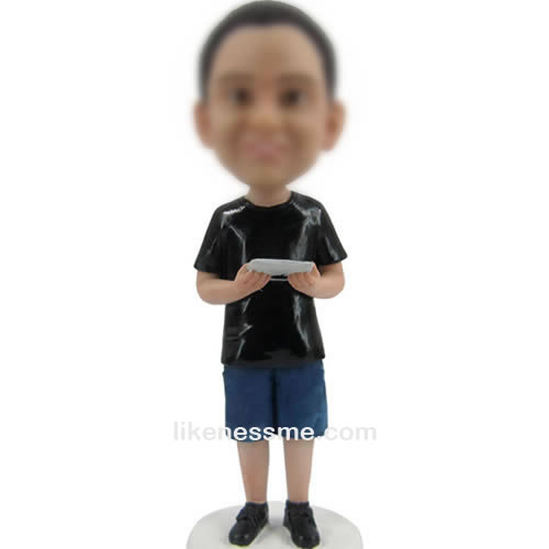bobbleheads of man with IPAD