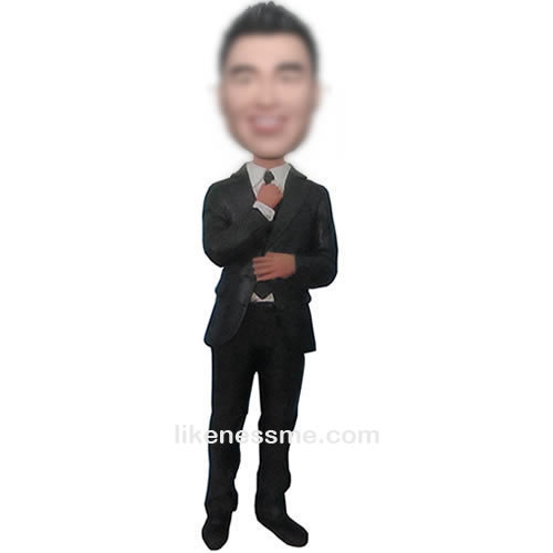 man in black suit bobble head doll