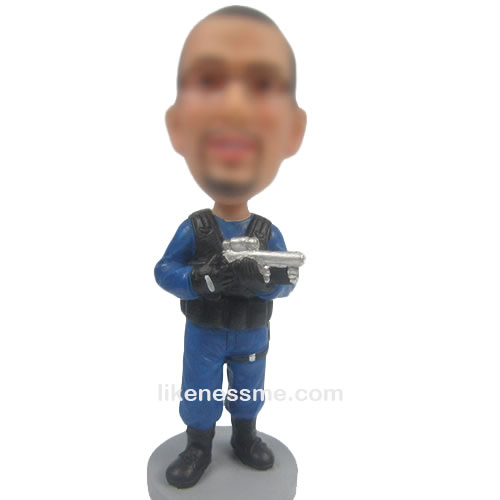 professional man with gun bobble head doll